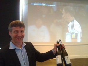 Gunter Kunstler of Weingut Kunstler celebrates a German goal in a World Cup game televised at the tasting in SF.