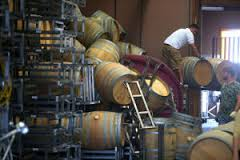 Workers move fallen wine barrels at Saintsbury Winery following the large earthquake in Napa. (credit Aric Crabb)