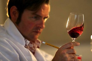Judge Christopher Sawyer checks the color of a zinfandel at the Sonoma County Harvest Fair wine competition. (JOHN BURGESS / The Press Democrat)
