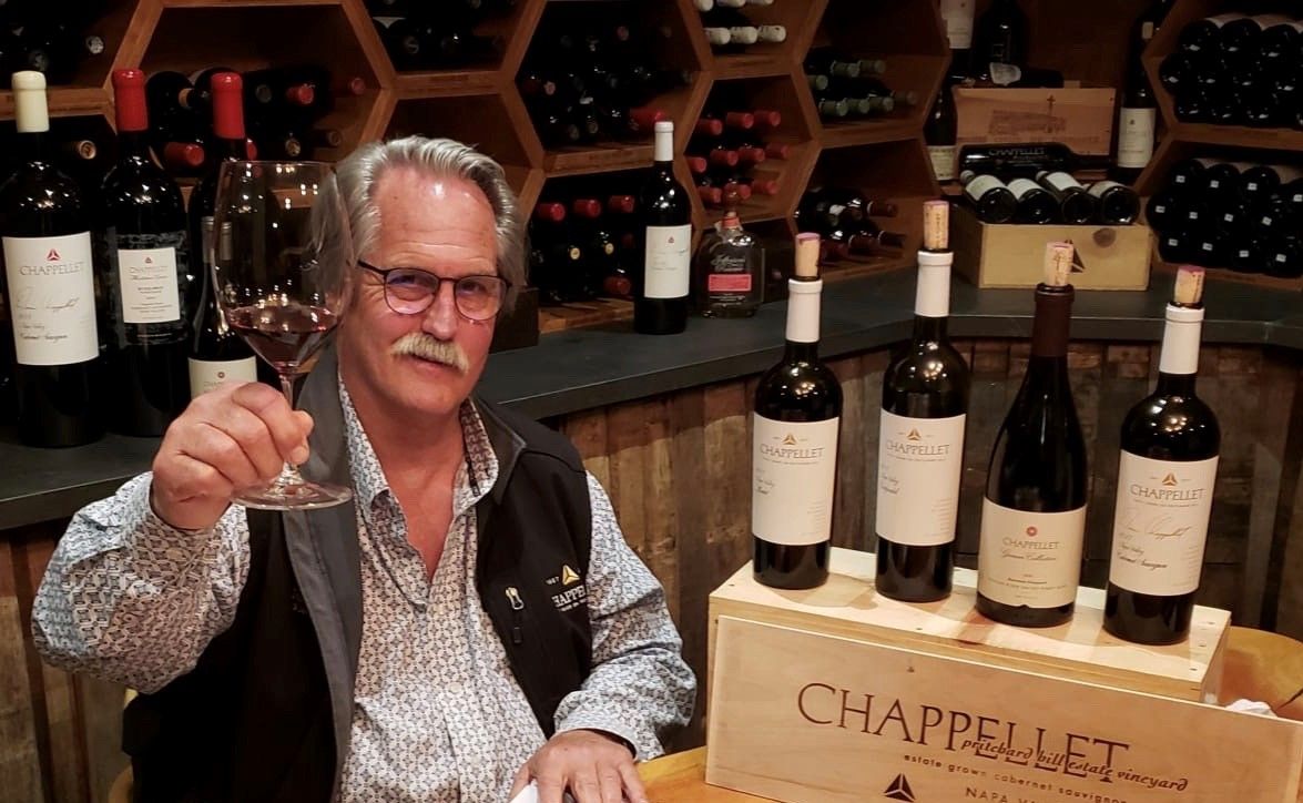 Cyril Chappellet toasting with wine bottles